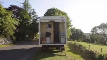 Couple pack it all in and move into their new mobile home – an old white van